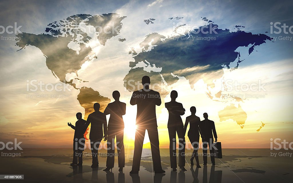 A silhouette of a team of businesspeople standing stock photo