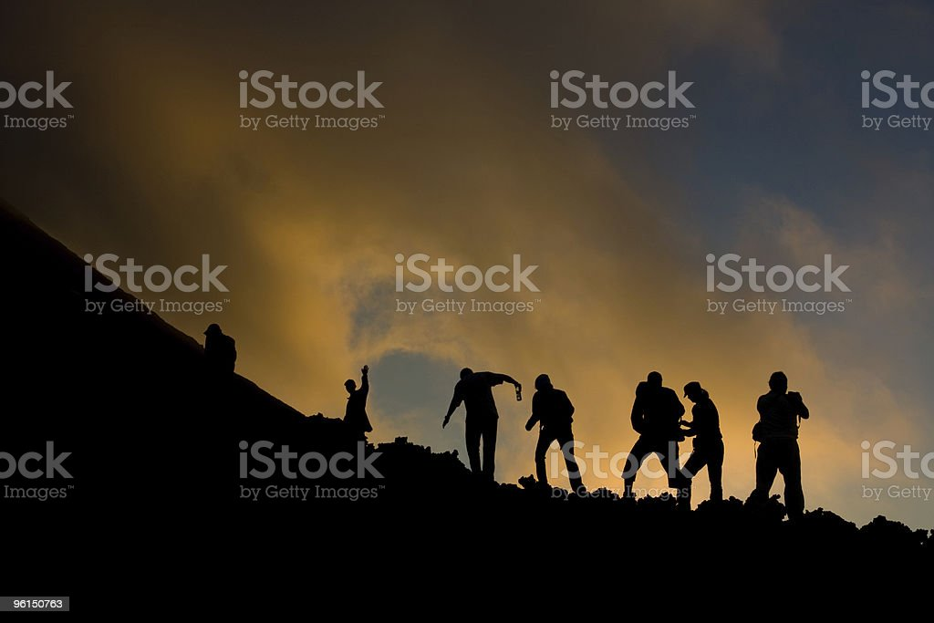 Silhouette of a team on a mountain stock photo