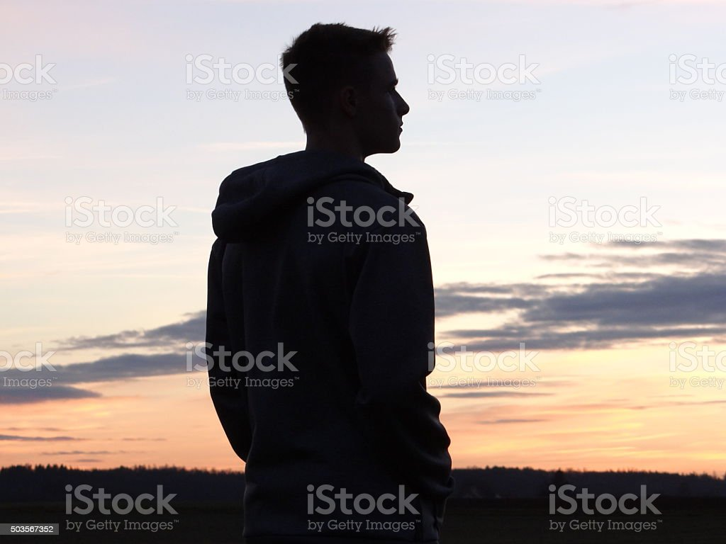 Silhouette of a teenager stock photo