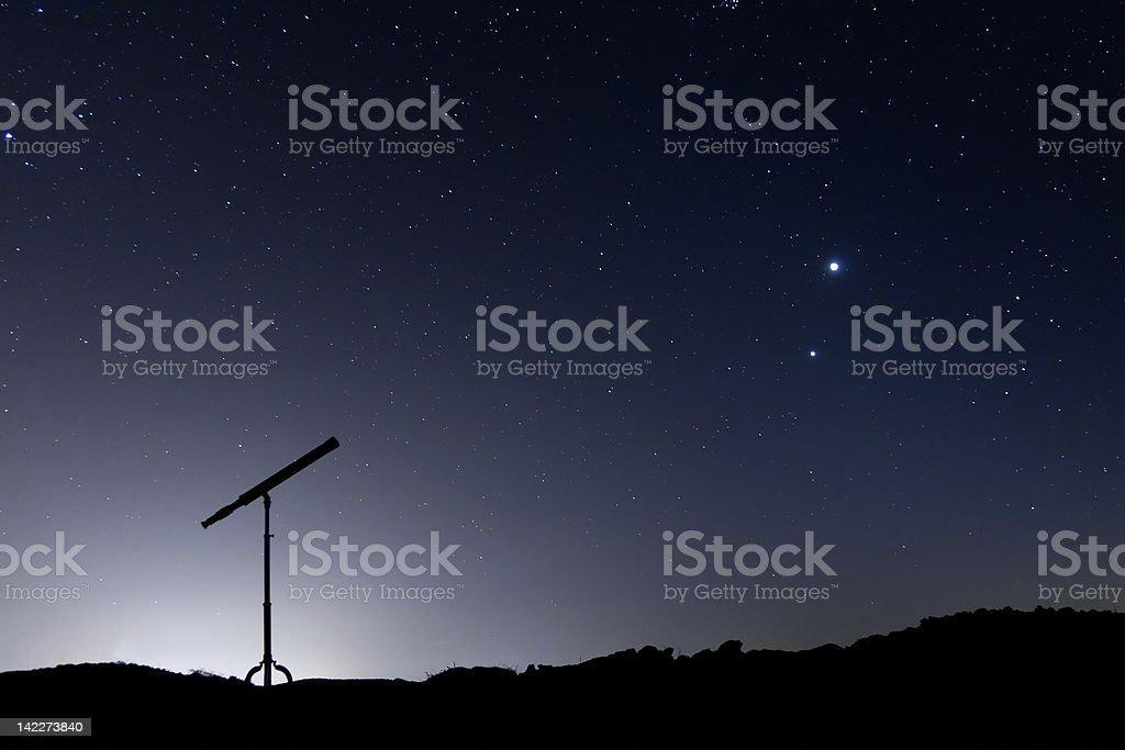 Silhouette of a telescope stock photo