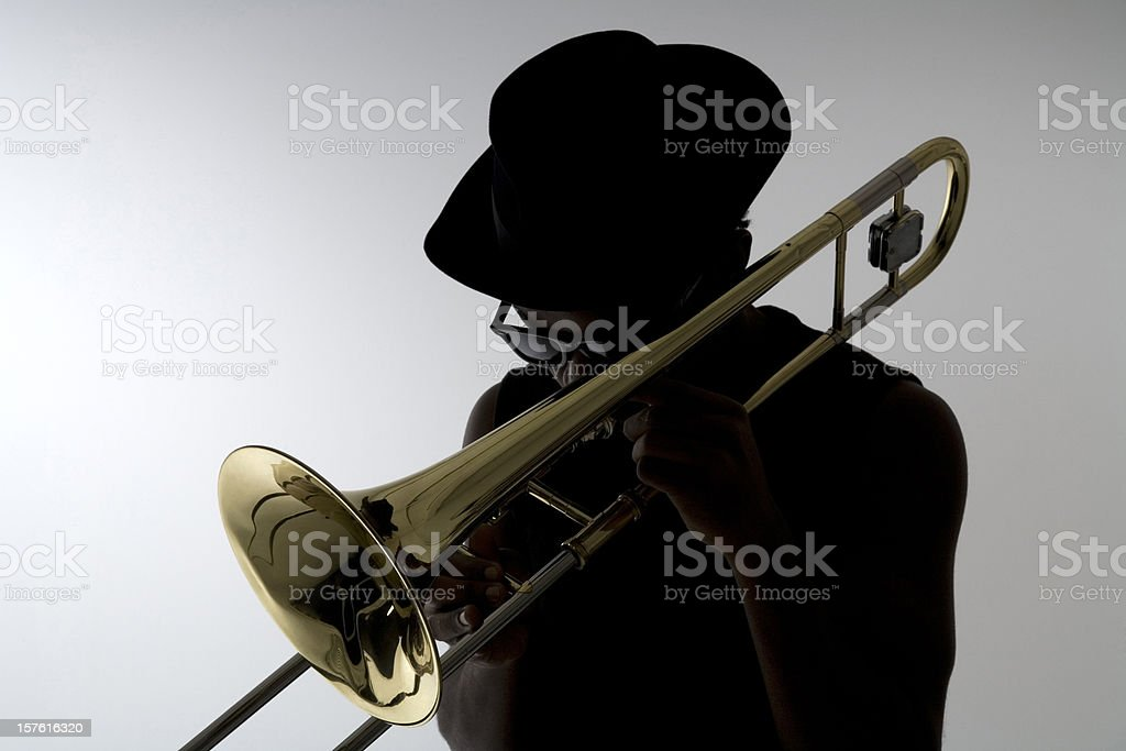 Silhouette of a trombonist stock photo