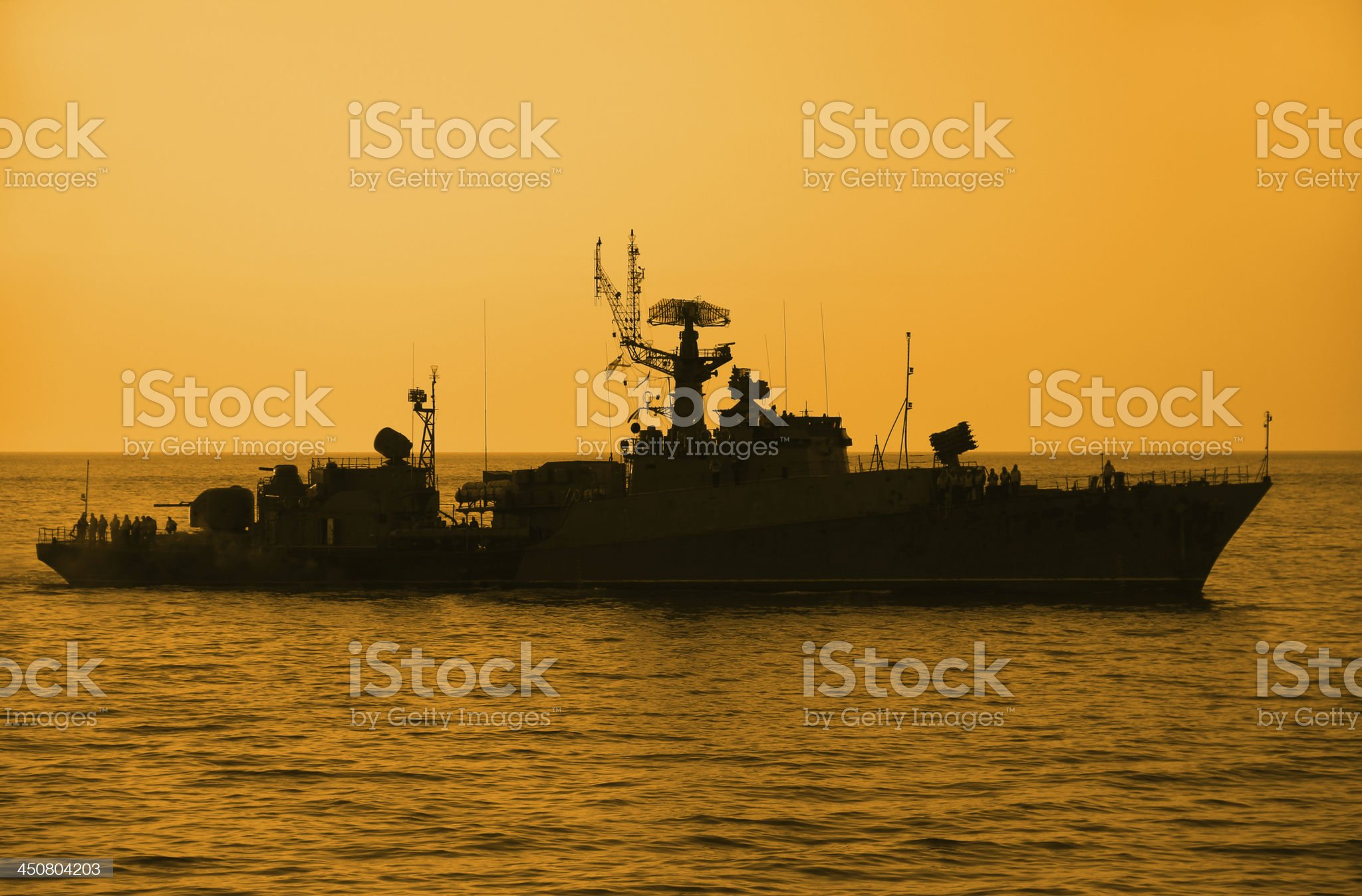silhouette of a warship at sunset royalty-free stock photo