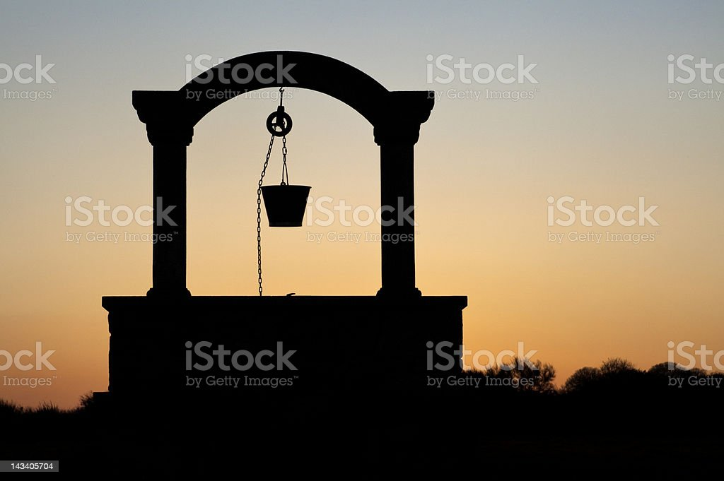 silhouette of a well stock photo