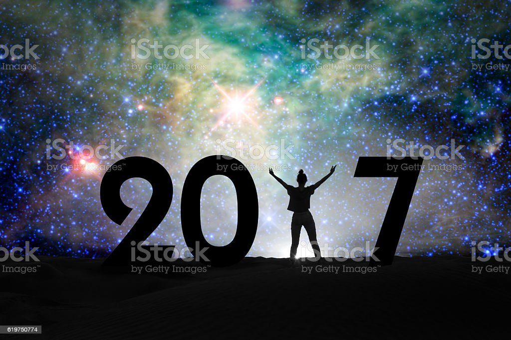 2017, silhouette of a woman and starry night stock photo