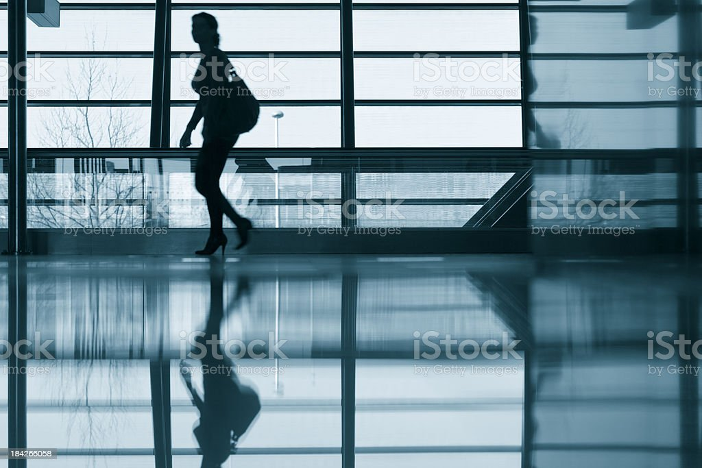 Silhouette of a woman at airport royalty-free stock photo