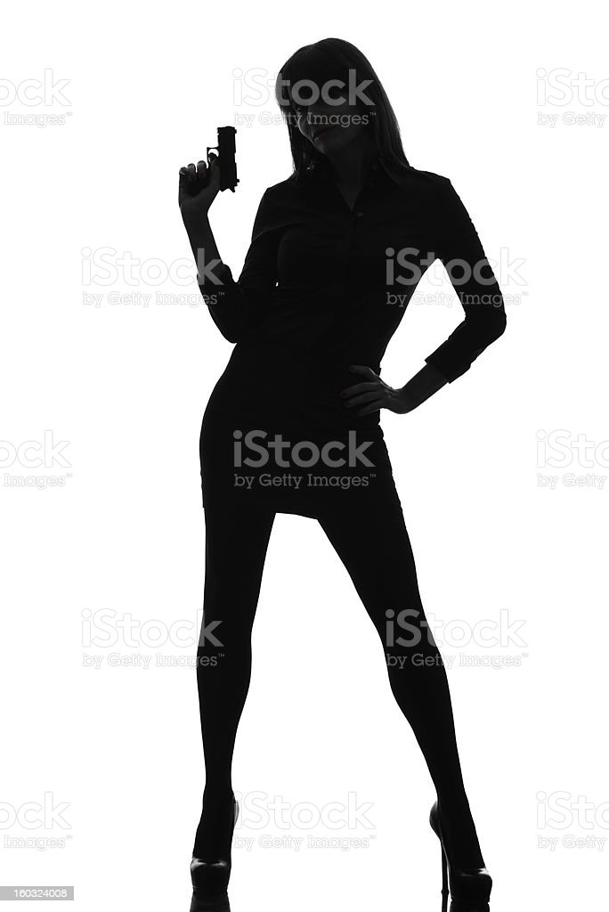 A silhouette of a woman holding a gun stock photo
