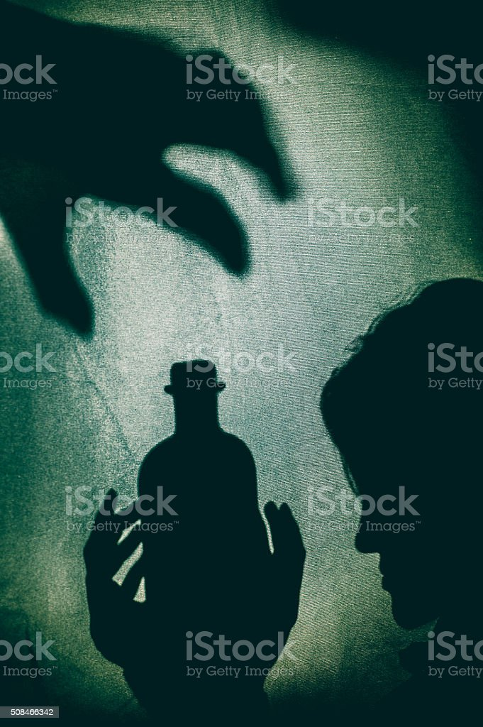 Silhouette of a Woman Holding Love Potion stock photo
