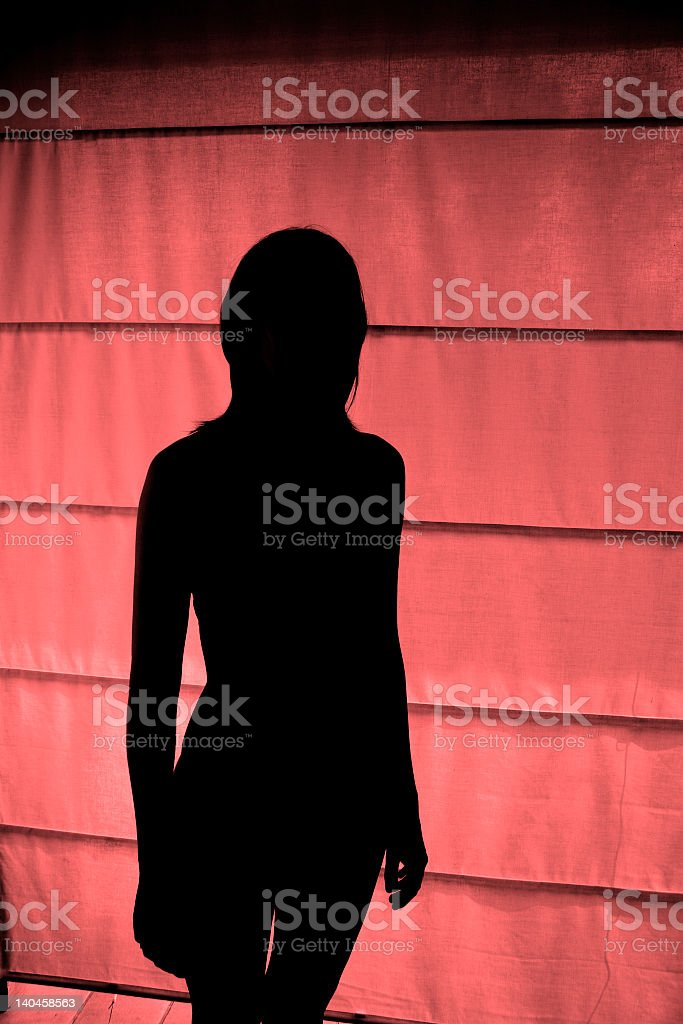Silhouette of a woman in the red light district royalty-free stock photo