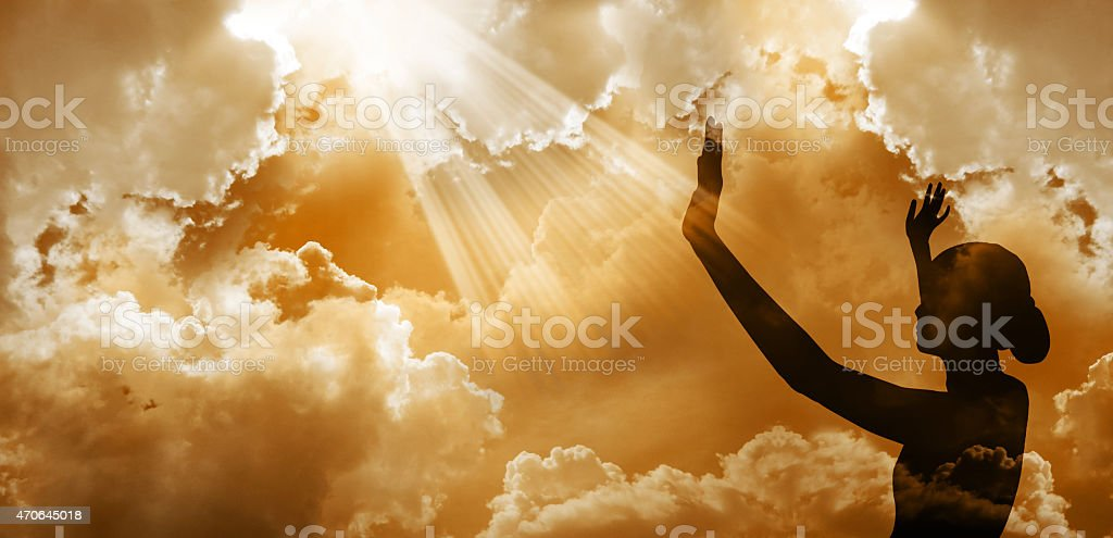 Silhouette of a woman looking at the sky stock photo