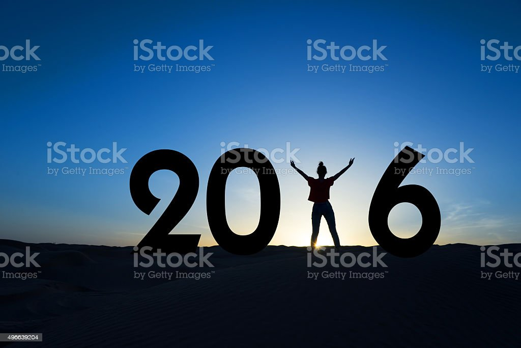 2016, silhouette of a woman standing in the sun stock photo