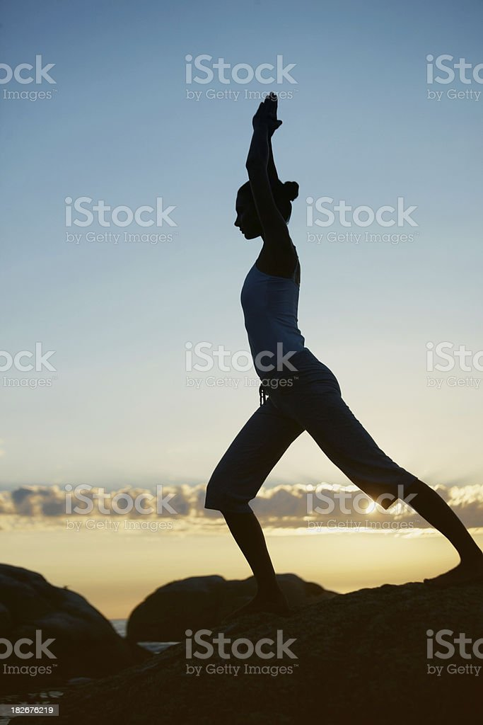 Silhouette of a woman with joined hands against sky royalty-free stock photo