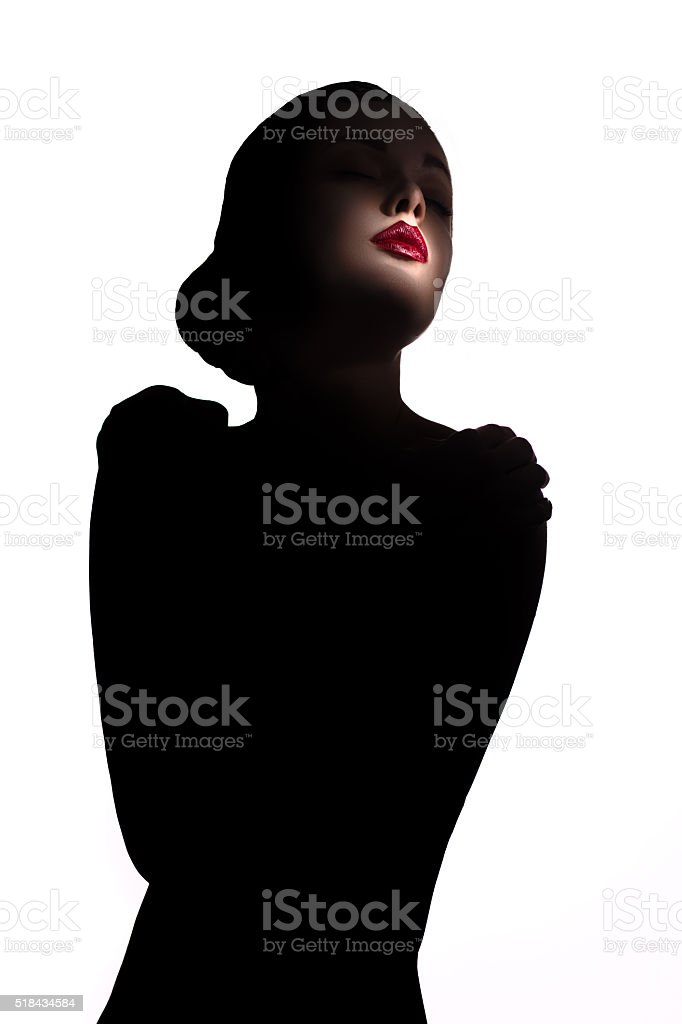 Silhouette of a woman with red lipstick stock photo