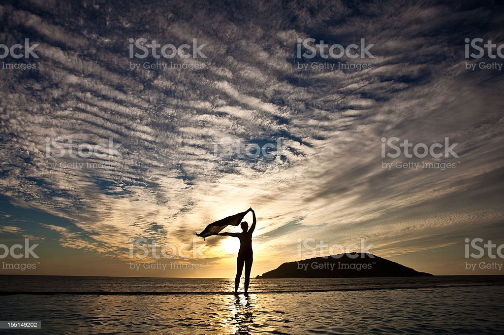 Silhouette of a Woman With Shawl at Infinity Pool royalty-free stock photo