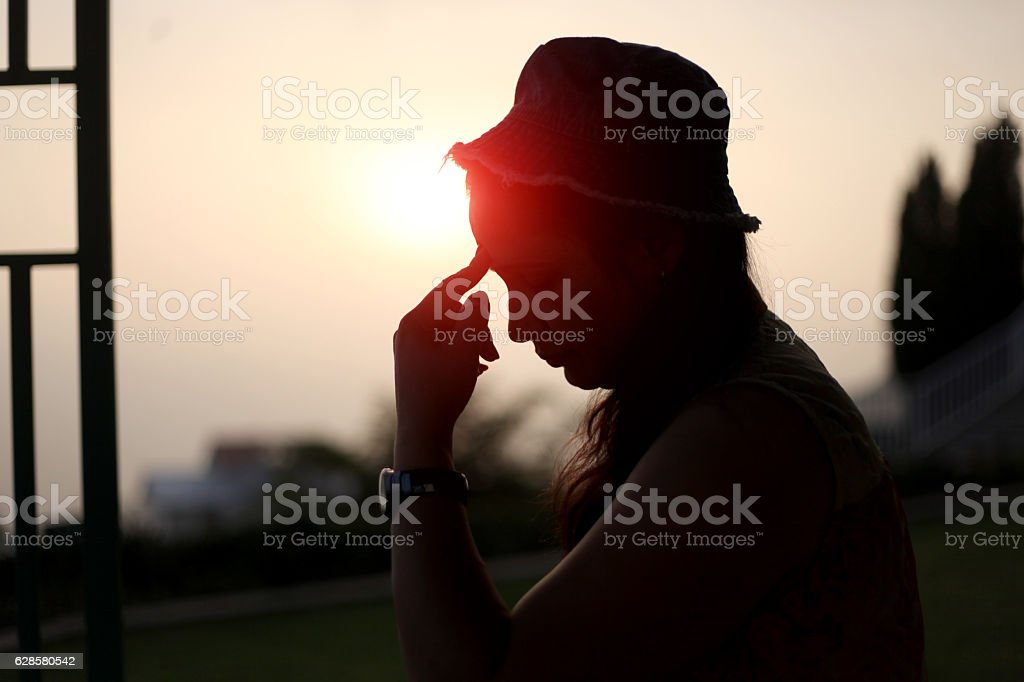 Silhouette of a women thinking something stock photo