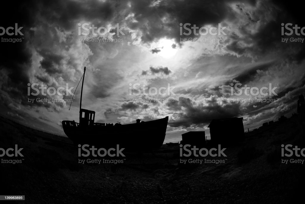 Silhouette of Abandoned Boat royalty-free stock photo
