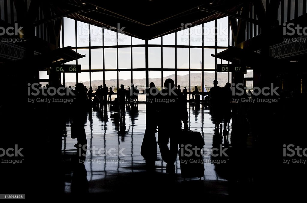Silhouette of airport concourse stock photo