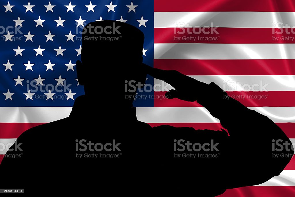 Silhouette of American (USA) soldier saluting to USA flag stock photo