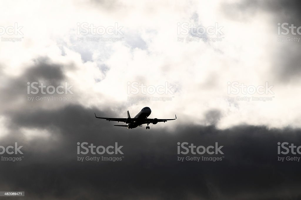 Silhouette of an Airplane stock photo