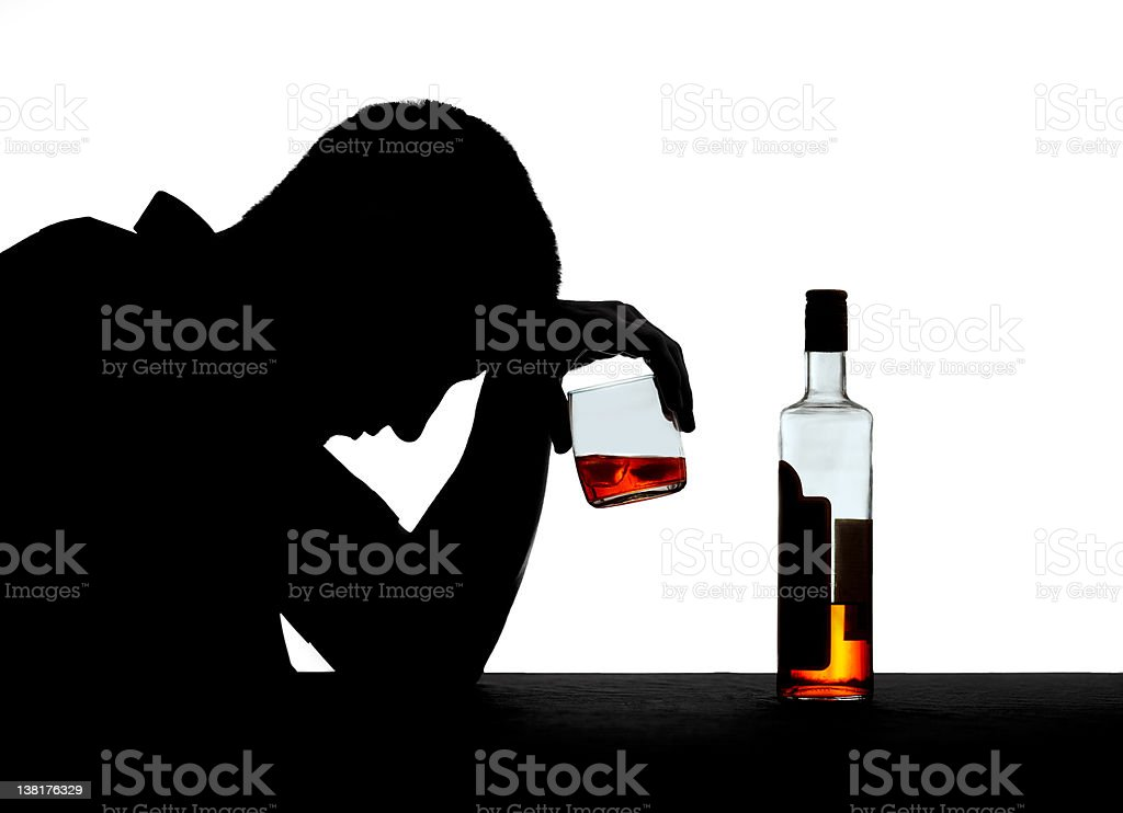 Silhouette of an alcoholic stock photo
