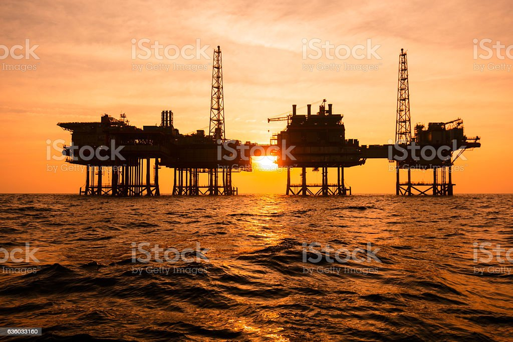 Silhouette of an offshore oil installation stock photo