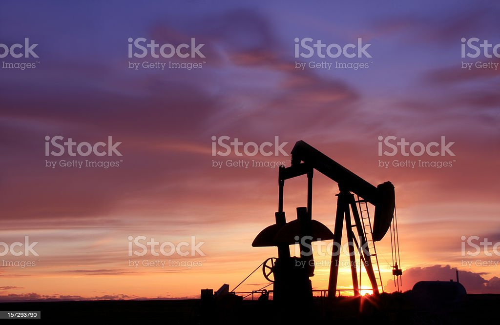 Silhouette of an Oil Industry Pumpjack in Canada royalty-free stock photo