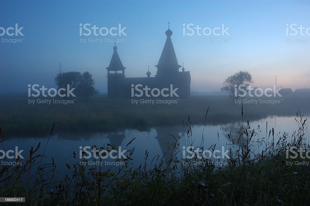 Silhouette of ancient wooden church at sunrise royalty-free stock photo