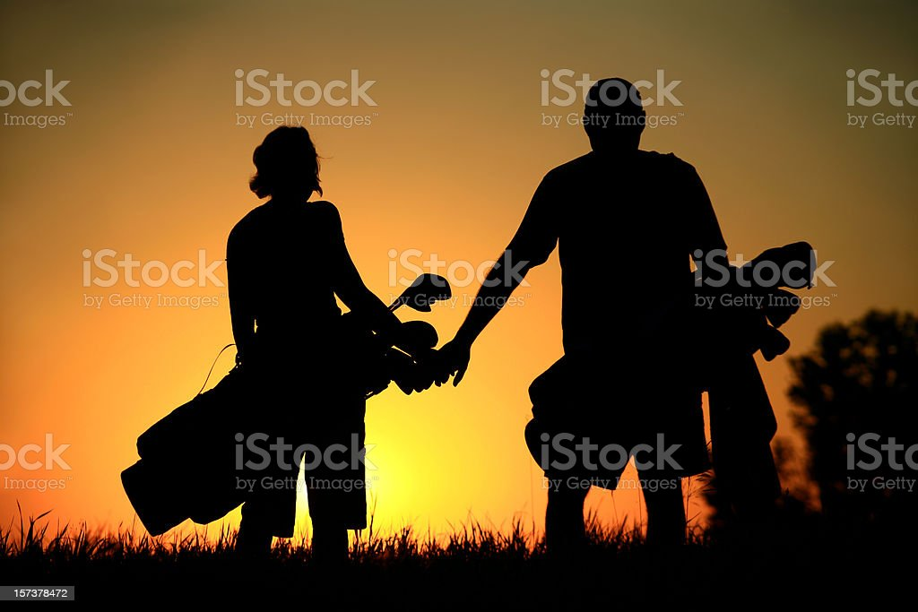 Silhouette of Attractive Healthy Couple on a Golf Course royalty-free stock photo
