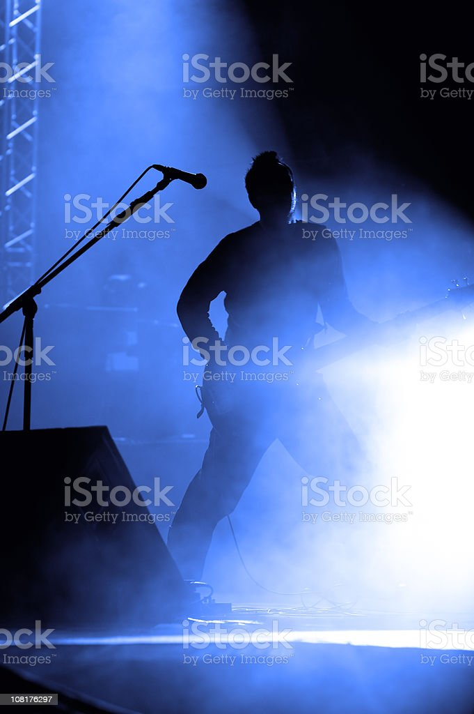 Silhouette of Band Member Playing Guitar stock photo
