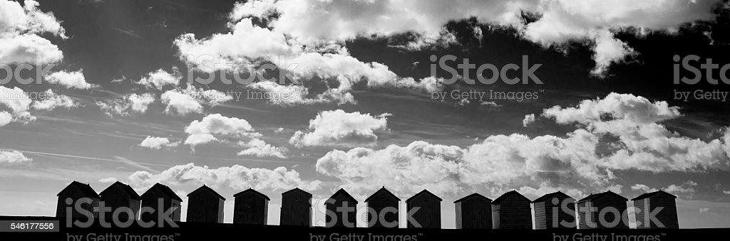 Silhouette of beach huts stock photo