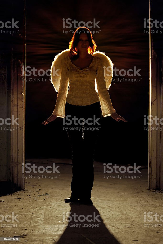 Silhouette of beautiful red head angel stock photo