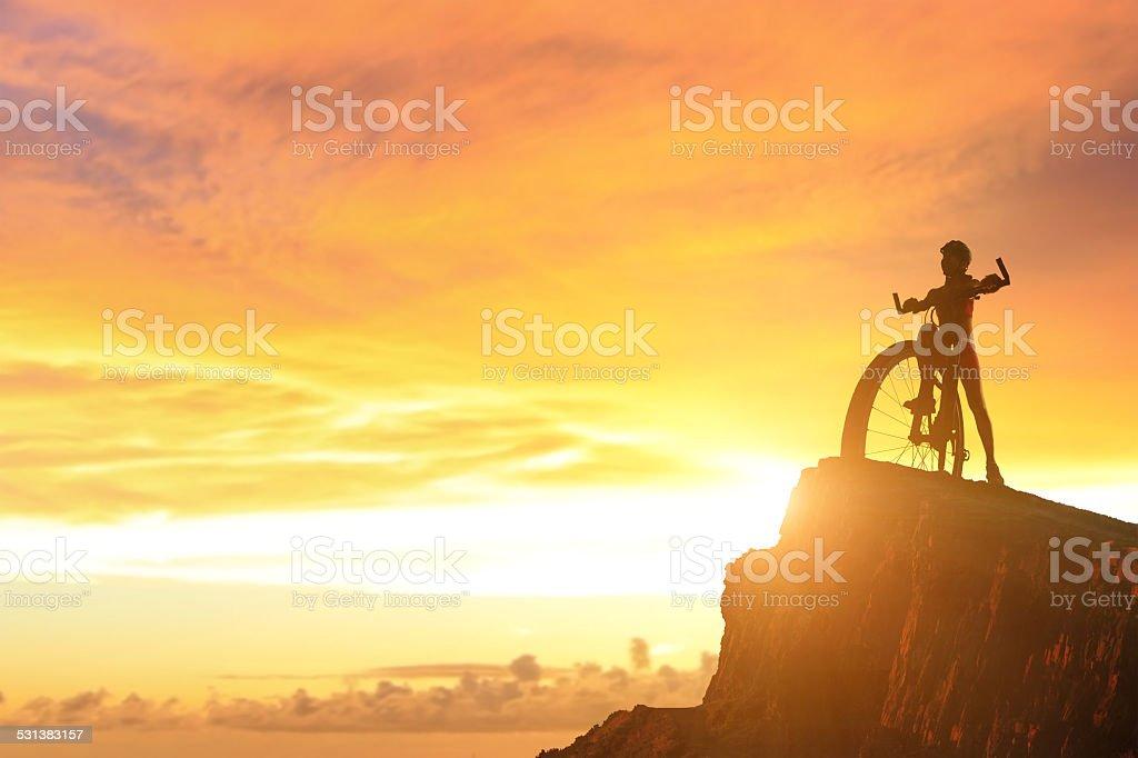 silhouette of Biker girl stock photo
