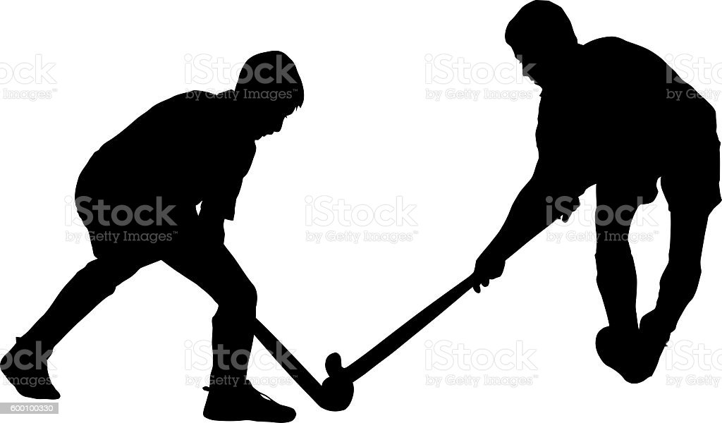 Silhouette of boy hockey players battling for possession of ball stock photo