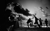 Silhouette of Boys Practicing Capoeira Martial Arts on Brazilian Beach