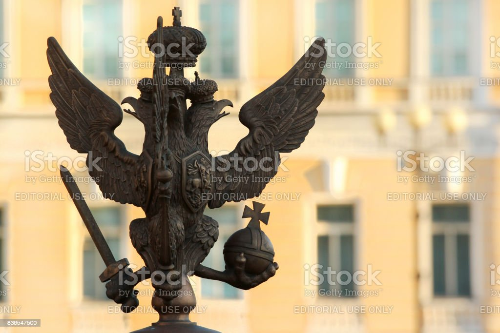 Silhouette of bronze double-headed eagle with sword, orb and cross in St.Petersburg, Russia stock photo