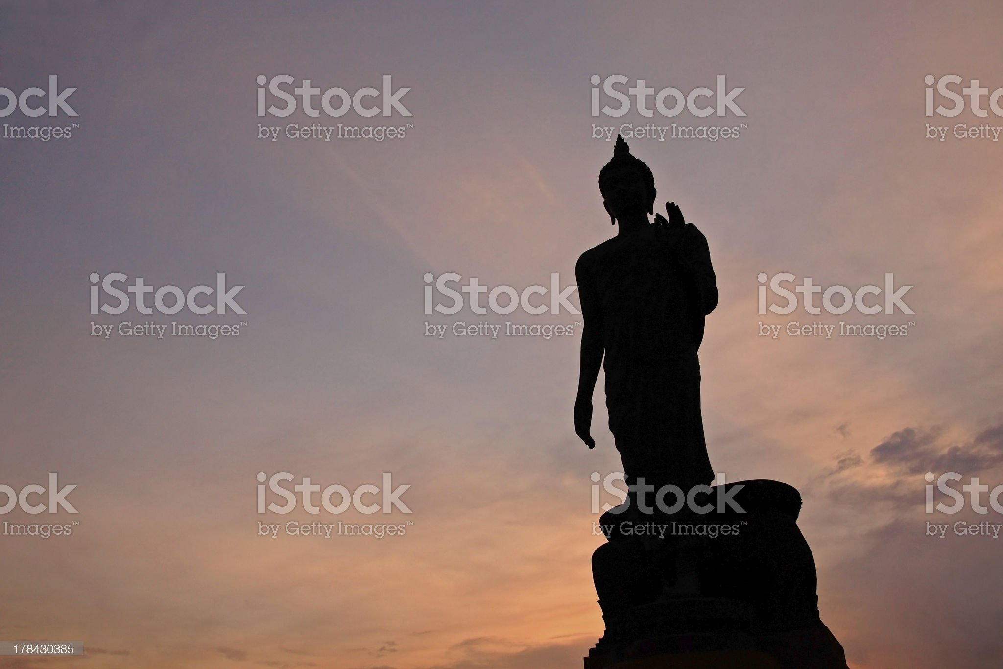 Silhouette of Buddha statue with ray light at twilight royalty-free stock photo
