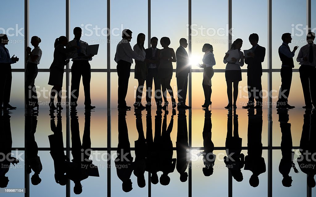 Silhouette of business colleagues working royalty-free stock photo