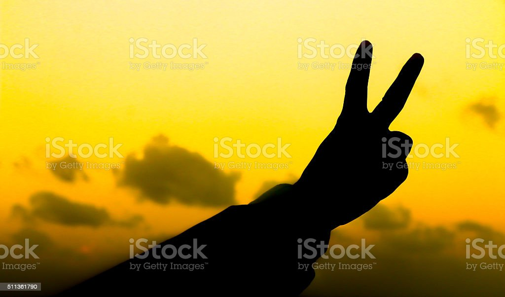 Silhouette of business man hand show two fingers stock photo