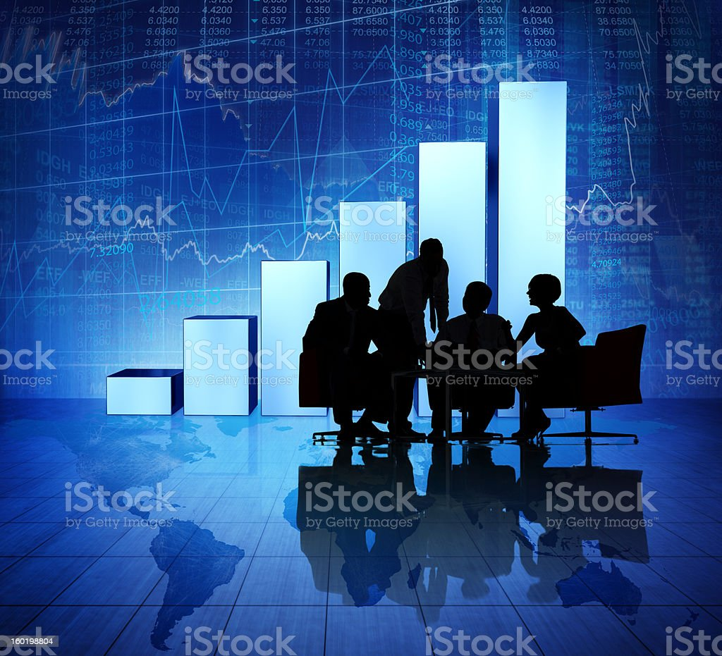 Silhouette of business meeting with global imagery royalty-free stock photo