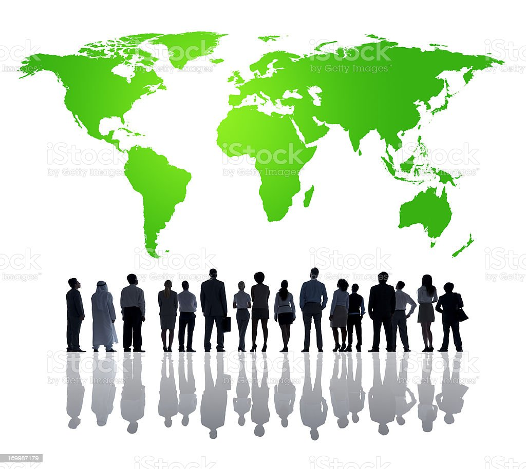 Silhouette of business people looking at green world map royalty-free stock photo