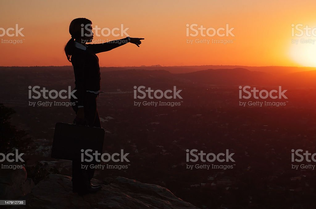 Silhouette of Business Woman on Hill top during Sunset royalty-free stock photo