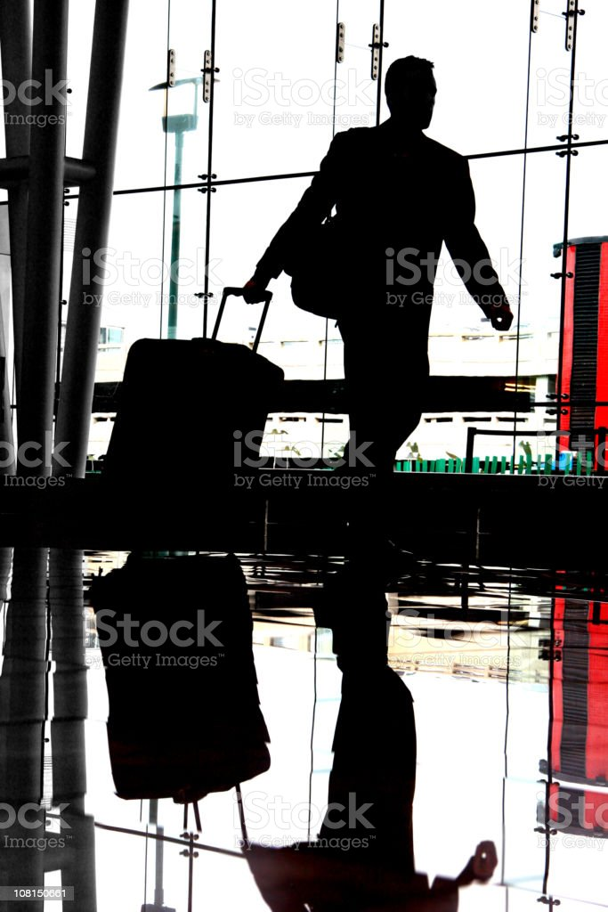 Silhouette of Businessman in Airport royalty-free stock photo