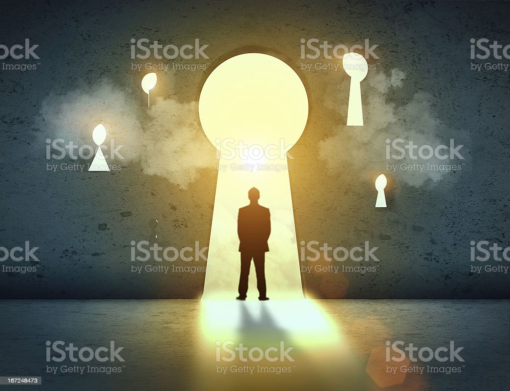 Silhouette of businessman in keyhole royalty-free stock photo
