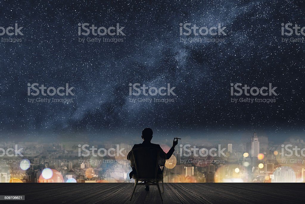 Silhouette of businessman sit stock photo