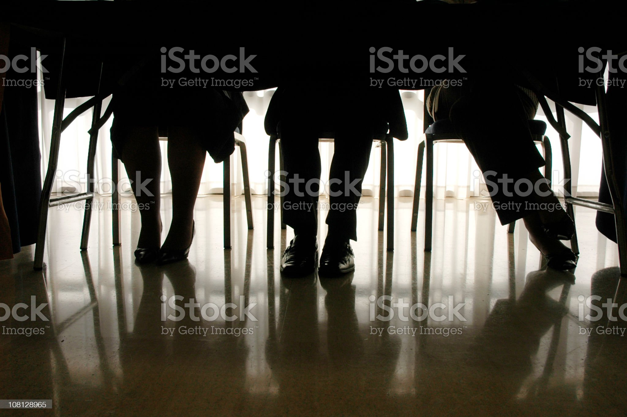 Silhouette of Businessmen and Women's Legs royalty-free stock photo