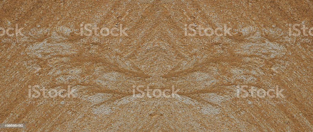 Silhouette of butterfly wings made of sand and gravel royalty-free stock photo