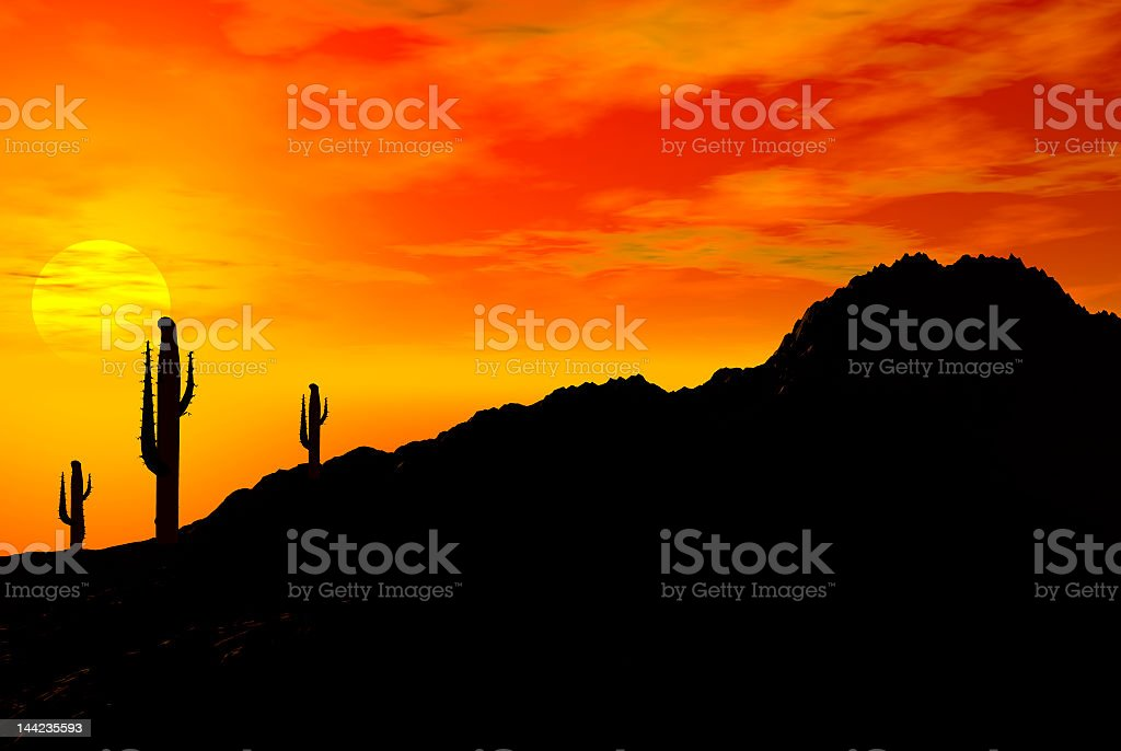 Silhouette of cactus and of a hill against sunset stock photo
