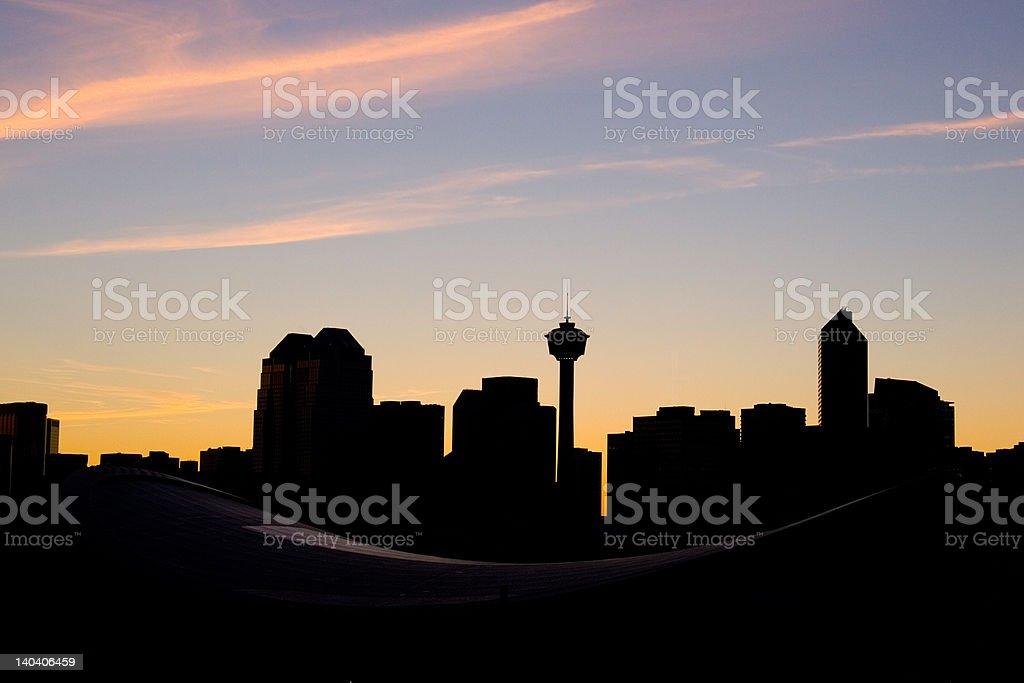 Silhouette of Calgary skyline at sunset royalty-free stock photo