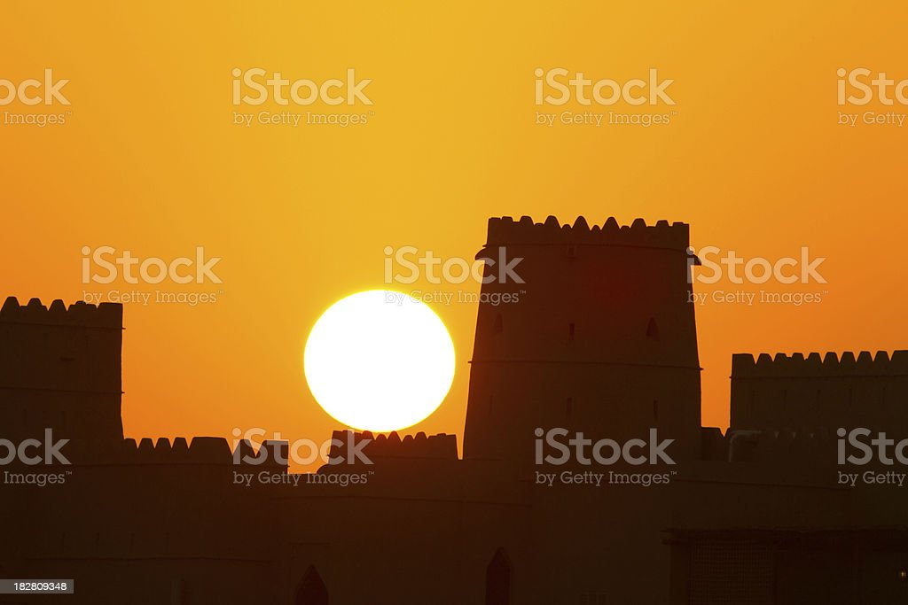 silhouette of castle at sunrise royalty-free stock photo