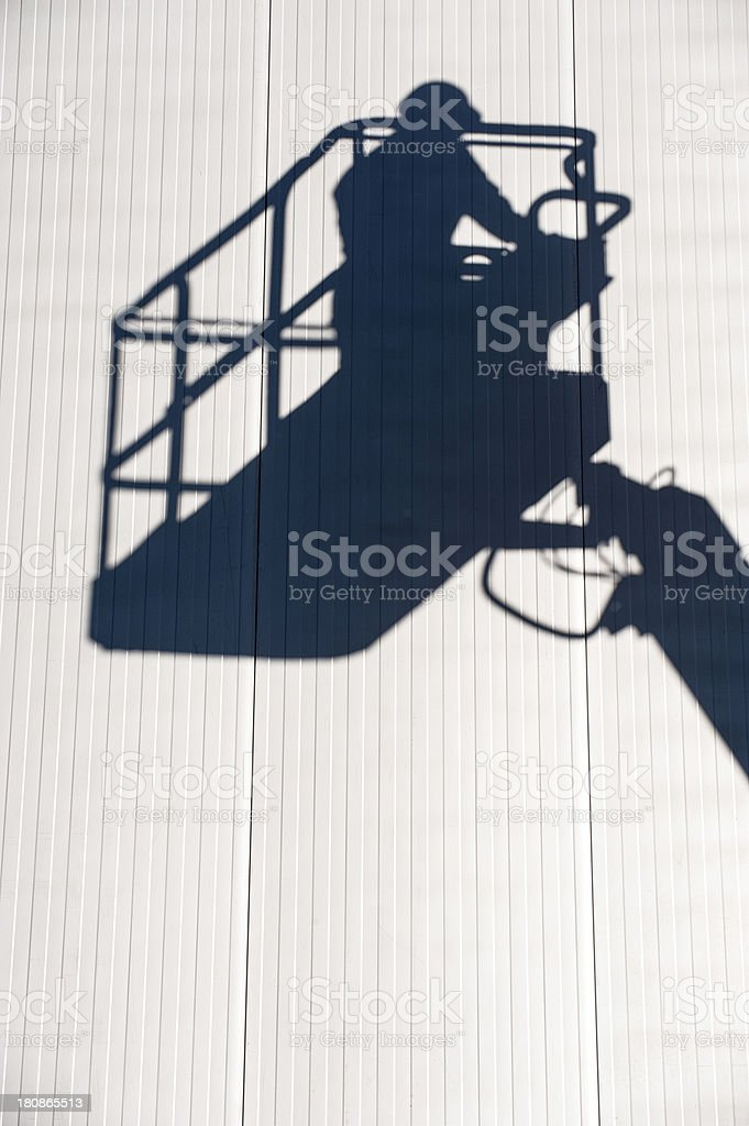 silhouette of cherry picker royalty-free stock photo