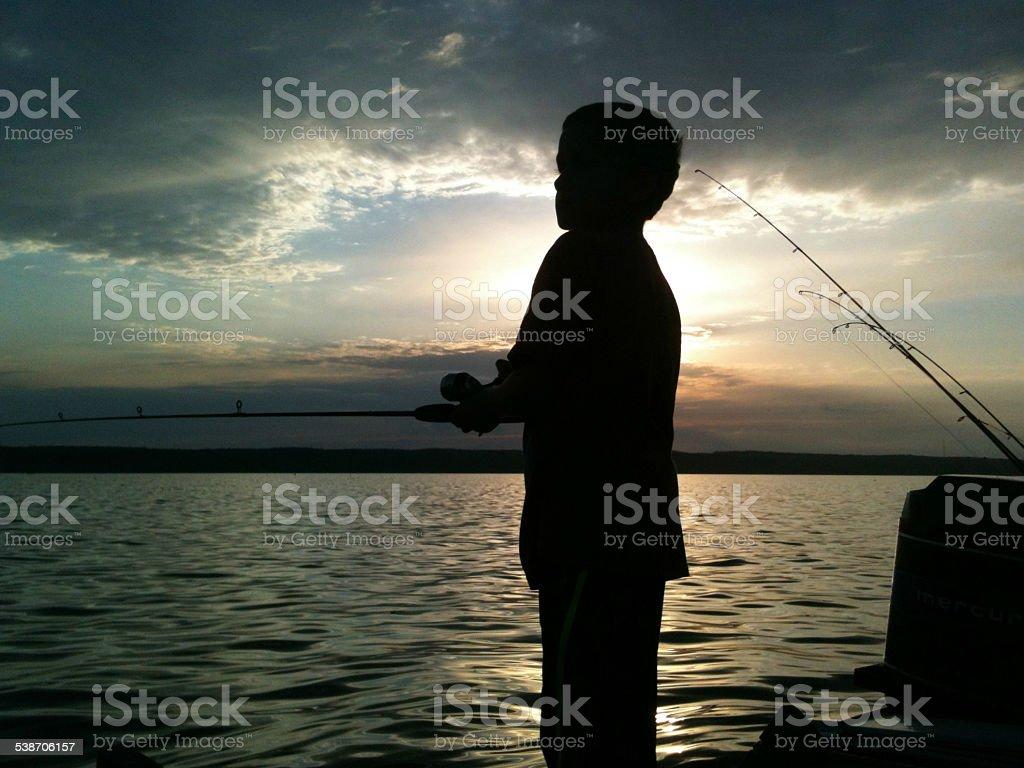 Silhouette of Child Fishing Northern Michigan Fletcher Pond stock photo